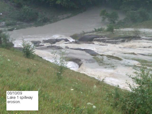 Closeup of Reservoir #1 overflowing spillway Monday morning (WVES photo, 7:57AM 8/10)