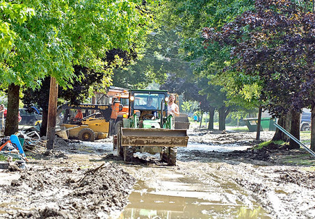 [NYDH photo of mud cleanup in Gowanda, NY following Aug. 9, 2009 flood]